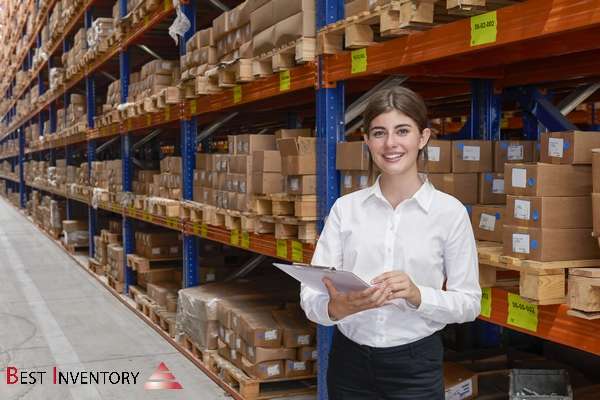Female worker checking the storages in warehouse