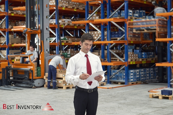 Male worker checking the storages in warehouse